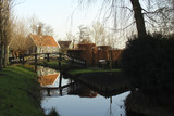 rustic landscape in Dutch style, wooden cottage, bridge, canal, winter, Holland - 209228468