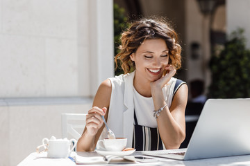 A Woman Freelancer Reading on Her Laptop