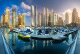 Day view of sea bay with yachts Dubai Marina, UAE