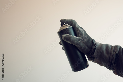Graffiti artist holding color spray can