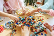 Leinwanddruck Bild - mosaic puzzle art for kids, children's creative game. two sisters are playing mosaic