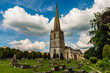 An ancient church and graveyard in the scenic Cotswolds area of England on a summers day (Painswick) - 209244203
