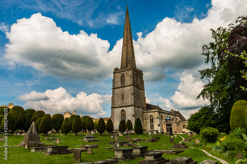 Poster An ancient church and graveyard in the scenic Cotswolds area of England on a summers day (Painswick)