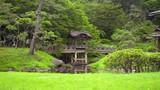 zoom in on arch wooden bridge in japanese garden - 209248455