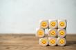 Leinwandbild Motiv Viele Würfel mit lächelnden Smileys und einer der unzufrieden ist