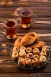 Leinwanddruck Bild - Turkish sweet baklava on plate with Turkish tea.