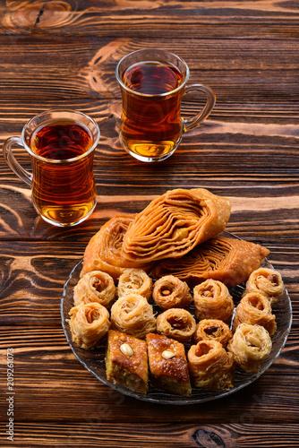 Leinwanddruck Bild Turkish sweet baklava on plate with Turkish tea.