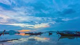 time lapse sunrise above fishing boats in Rawai sea during high tide - 209262836
