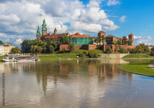 Poster Krakow, Poland - the second biggest city in Poland, Krakow offers a mix of history and modernity. Here in the picture a perspective of the Old Town and the famous Wawel Castle, on the Vistula river