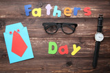Inscription Fathers Day with glasses and paper shirt on wooden table - 209267848