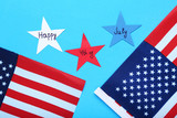 American flags with paper stars on blue background - 209268070
