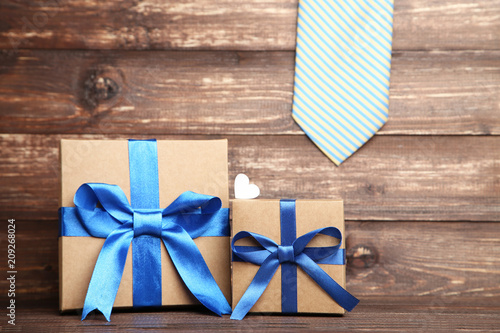 Foto Murales Fathers Day concept with tie on wooden background
