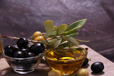 Bottle virgin olive oil and oil in a bowl with some olives - 209268260
