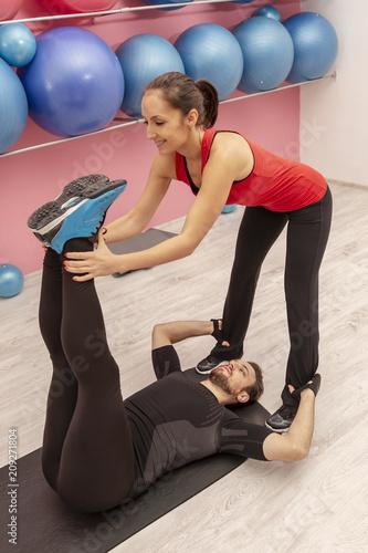 Plexiglas Fitness Couple Training in a Gym