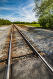 Railroad Tracks disappearing Into the Distance - 209278860