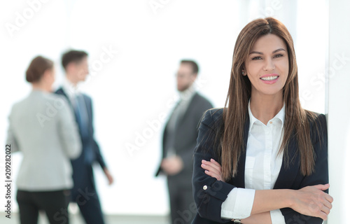 young business woman on blurred office background. - 209282022