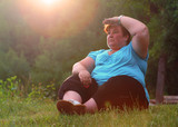 Overweight hiker woman relaxing and meditating in a deep forest. Active lifestyle and mental health theme.  - 209282837