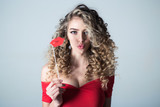 Portrait of funny positive curly hair girl with lips on stick. Woman with curly hair. Makeup and cosmetics for skin care. Beauty and style. Professional hair care. Hairdresser. - 209291891