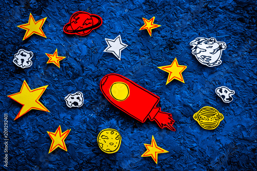 Space research concept. Drawn stars and rocket or space shuttle on blue outer space background top view - 209292401