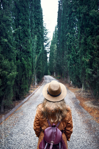 Tourist in hat at cypress alley