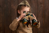 child girl are dressed as soldier in retro military uniforms - 209305697