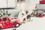 modern christmas ornaments and car toy with tree, presents cones anise on white wooden background. merry christmas concept. seasonal greetings. happy holidays, xmas card, hygge - 209309038