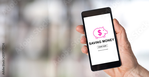 Saving money concept on a smartphone - 209309026
