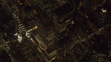 AERIAL: Lit Chrysler Building and Midtown Manhattan streets shining at night - 209317240