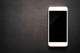 white mobile smartphone on luxury black background, top view. - 209318431