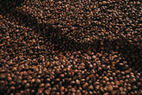 Close-up view of coffee beans roasted in professional machine - 209320624