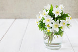 Bunch of white spring flowers in a glass - 209326882