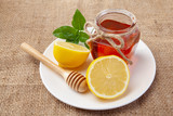 honey, lemon and ginger on a wooden background - 209327837