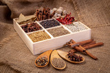 Set of spices (pepper, white pepper, black pepper, anise, caraway, coriander, cinnamon) in a wooden box. - 209329467