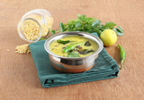 Dal curry, made from moong dal or mung, is a healthy, traditional and popular Indian vegetarian and delicious side dish for items like chapati and rice. - 209333039