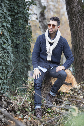 young sexy man posing in forest.autumn day
