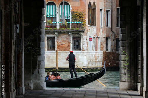Canals of Venice with gondola and gondolier