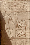 The fresco from the life of the pharaoh carved on the wall of the ancient temple of Karnak in Egypt