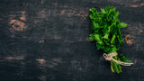 Fresh parsley. On a black wooden background. Top view. Copy space. - 209351452