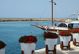 Quay Side.Beautiful ships on the background of red flowers in white flowerpots.The concept of sea voyage - 209355068