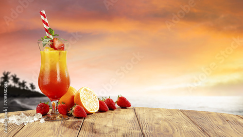 Leinwanddruck Bild fresh cold summer drink and golden sunset time