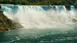 Cascade of incredible waterfalls - Niagara Falls. View from the Canadian side to the American coast