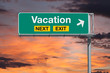 Vacation Next Exit Freeway Sign with Sunset Sky