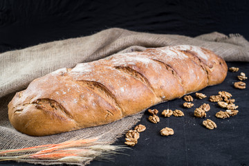 Dietic bread with nuts on wooden background