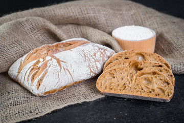 Sweet french bread on wooden background