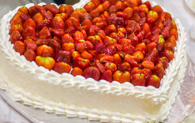 heart shaped wedding cake with strawberries