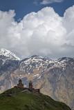 The dramatic view of Gergeti Church on a Kazbegi hilltop.