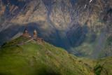 Gergeti Trinity Church dramatically perched on a hilltop.