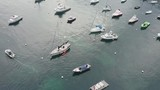 Aerial footage of boats and yachts mooring in the Avalon Bay, Santa Catarina Island, California, on a peaceful summer day - 209398017