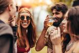 Friends enjoying at music festival - 209400873