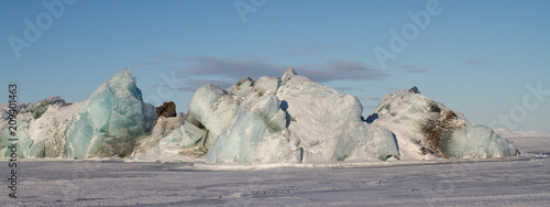 Svalbard - icebergs appearing through a frozen sea - Longyearbyen - the arctic circle - north pole tour expedition - 209401463